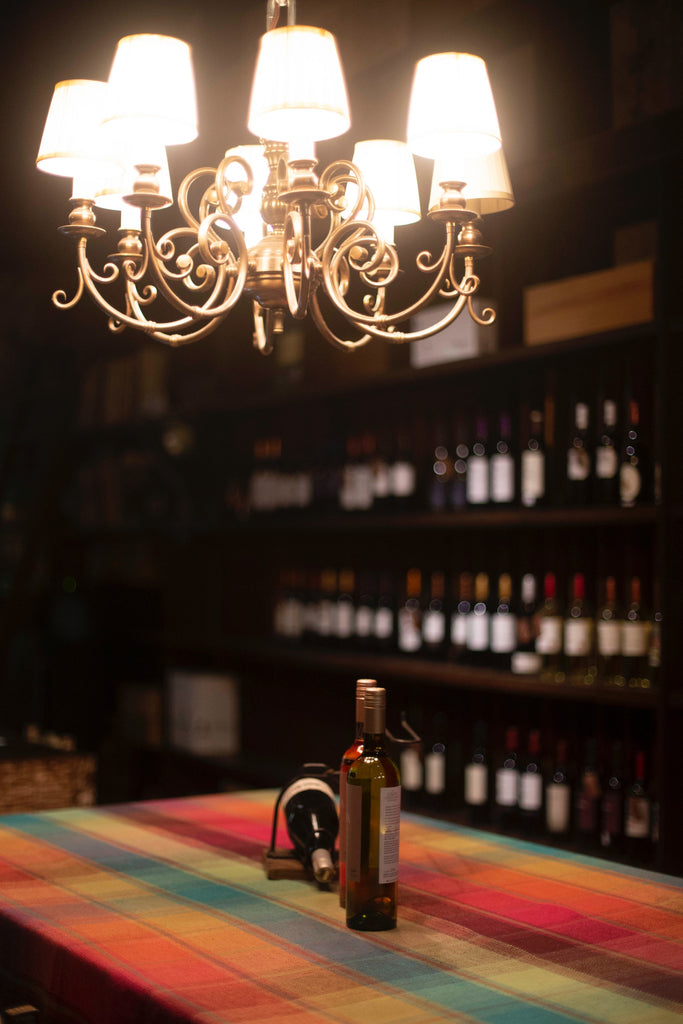 chandelier over bottles in wine cellar