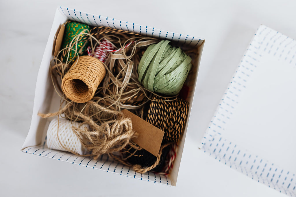 box of ribbons and thread