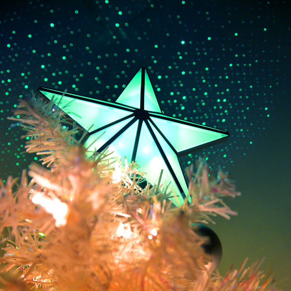 star tree topper with green laser star projections