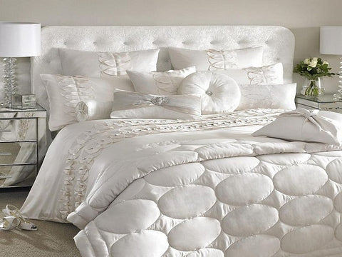 white bed sheet and duvet