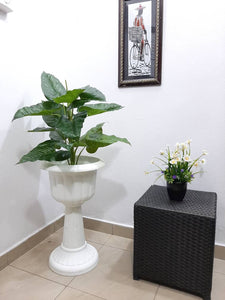 white decorative pot synthetic plant