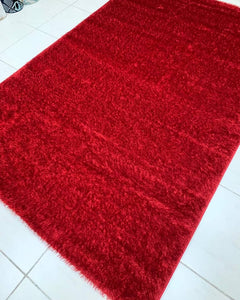 Beautiful red shaggy center rug