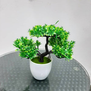 Small potted artificial plant tree
