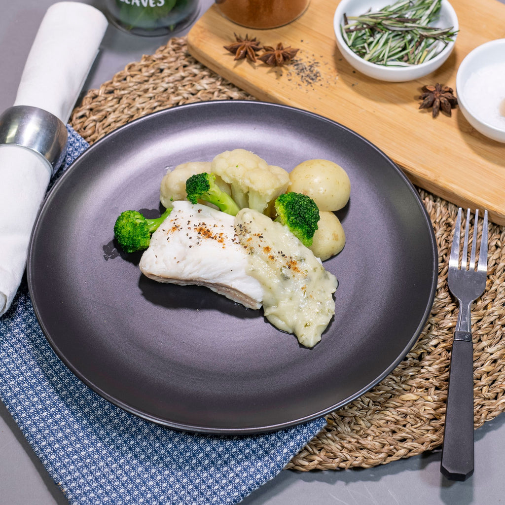 Poached White Fish by Contented Chef: Hake cooked in parley sauce, served with steamed potato, creamed spinach, glazed carrots