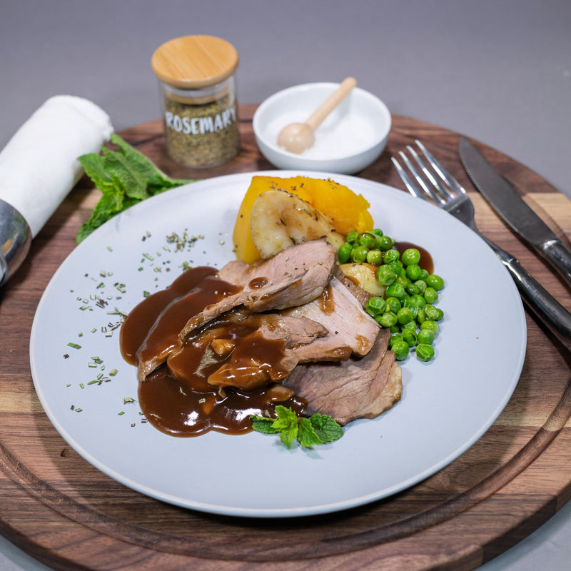 Roast Lamb by Contented Chef: Roasted leg of lamb served with roasted potatoes, roasted pumpkin, minted peas & our pan gravy