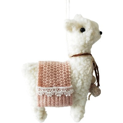 white hanging boho dllama decoration