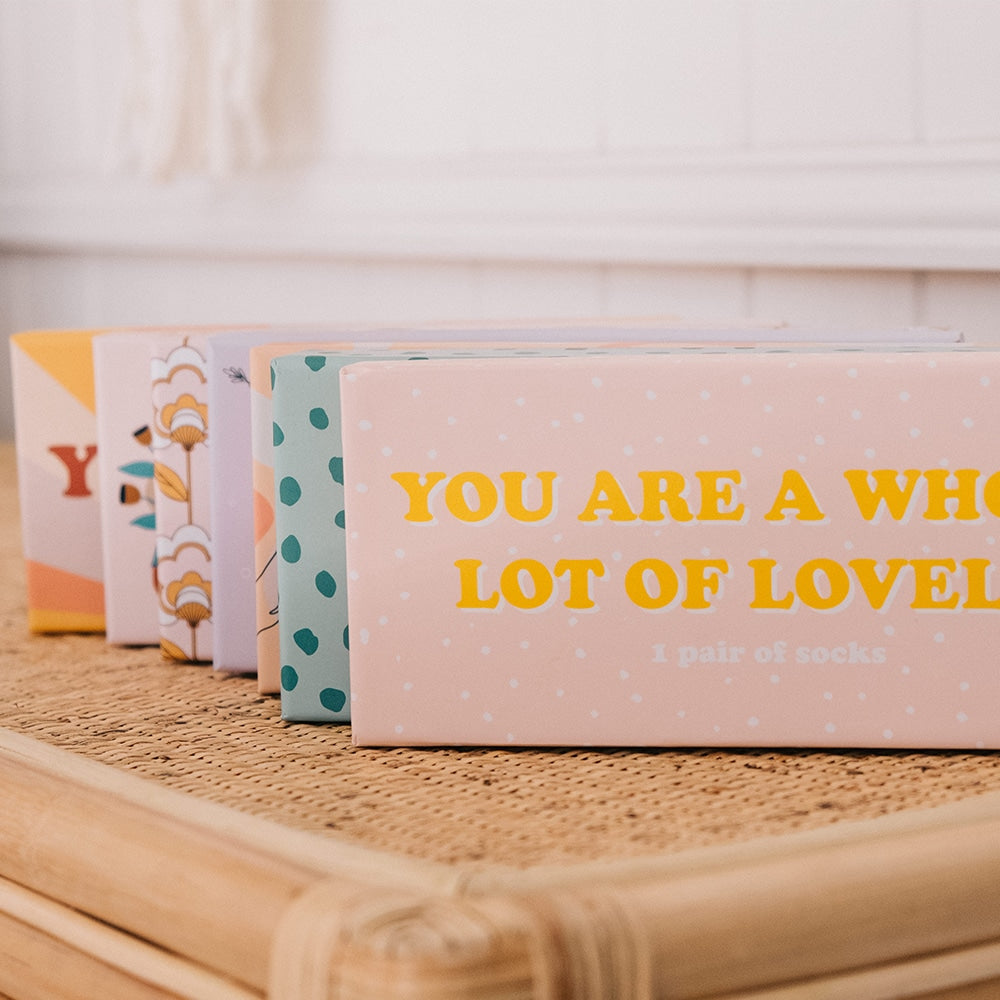 yellow and pink boxed socks for women with quote annabel trends