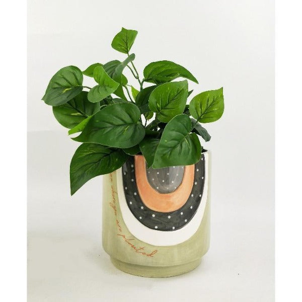 green and grey planter with quote