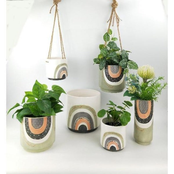 green and grey hanging planter with quote