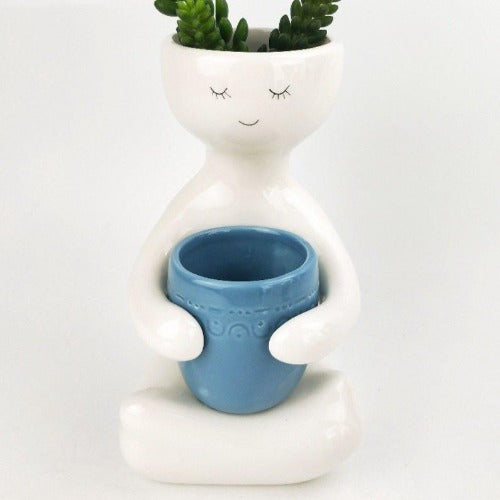 person holding blue pot