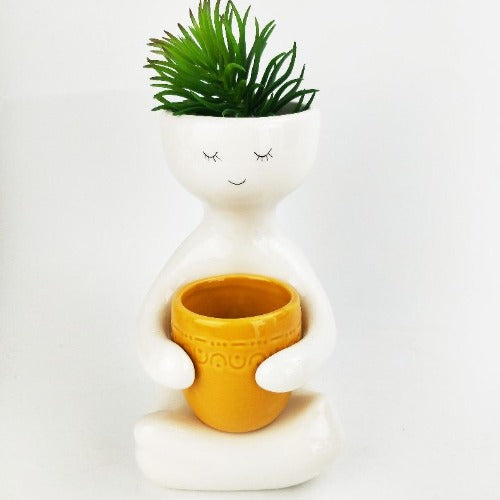 person holding yellow pot