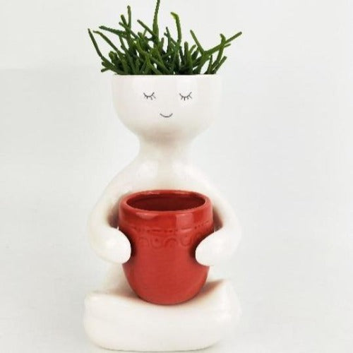 Person holding pot red