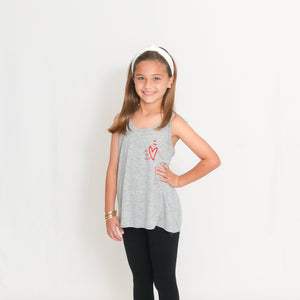 Girls Flowy Racerback Tank Top in light heather gray with Ari's Heart in red on left chest