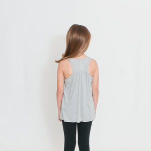 Rear view Girls Flowy Racerback Tank Top in light heather gray with Ari's Heart in red on left chest