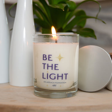 Be the Light Ari Arteaga Foundation Scented Candle Lit