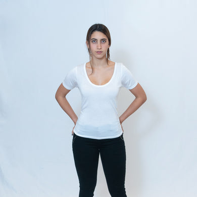 Deep scoop neck white t-shirt with Ari Arteaga's red heart on the left shoulder
