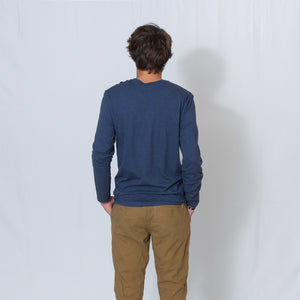 Rear View Heather Navy Crew Neck Long Sleeve T-shirt with Ari's Heart and Be the Light in Red on the Left Shoulder