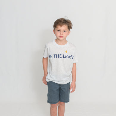 White Heather Youth Size T-Shirt with Be the Light Design in Blue Across the Chest
