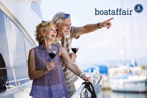 Couple having fun on a yacht with drinks