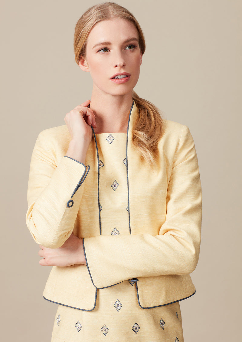 Honey yellow raw silk short fitted jacket with slate grey piping with matching dress