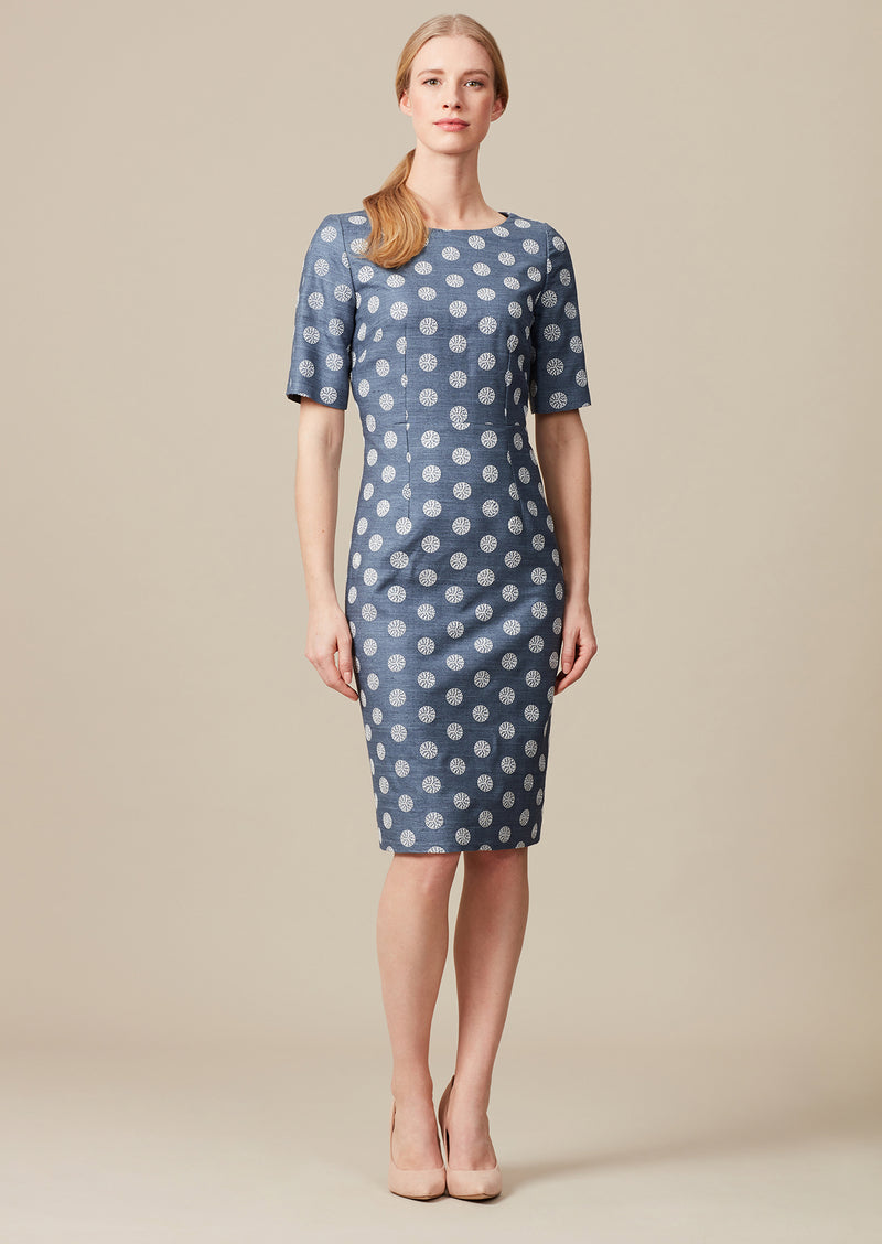 Embroidered silk dress for weddings with elbow length sleeves and large polka dot embroidery.