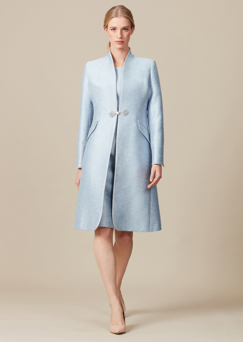 Elegant sky blue dress-coat in silk/cotton summer tweed with cord edge detailing and front and cuff frogging detail.