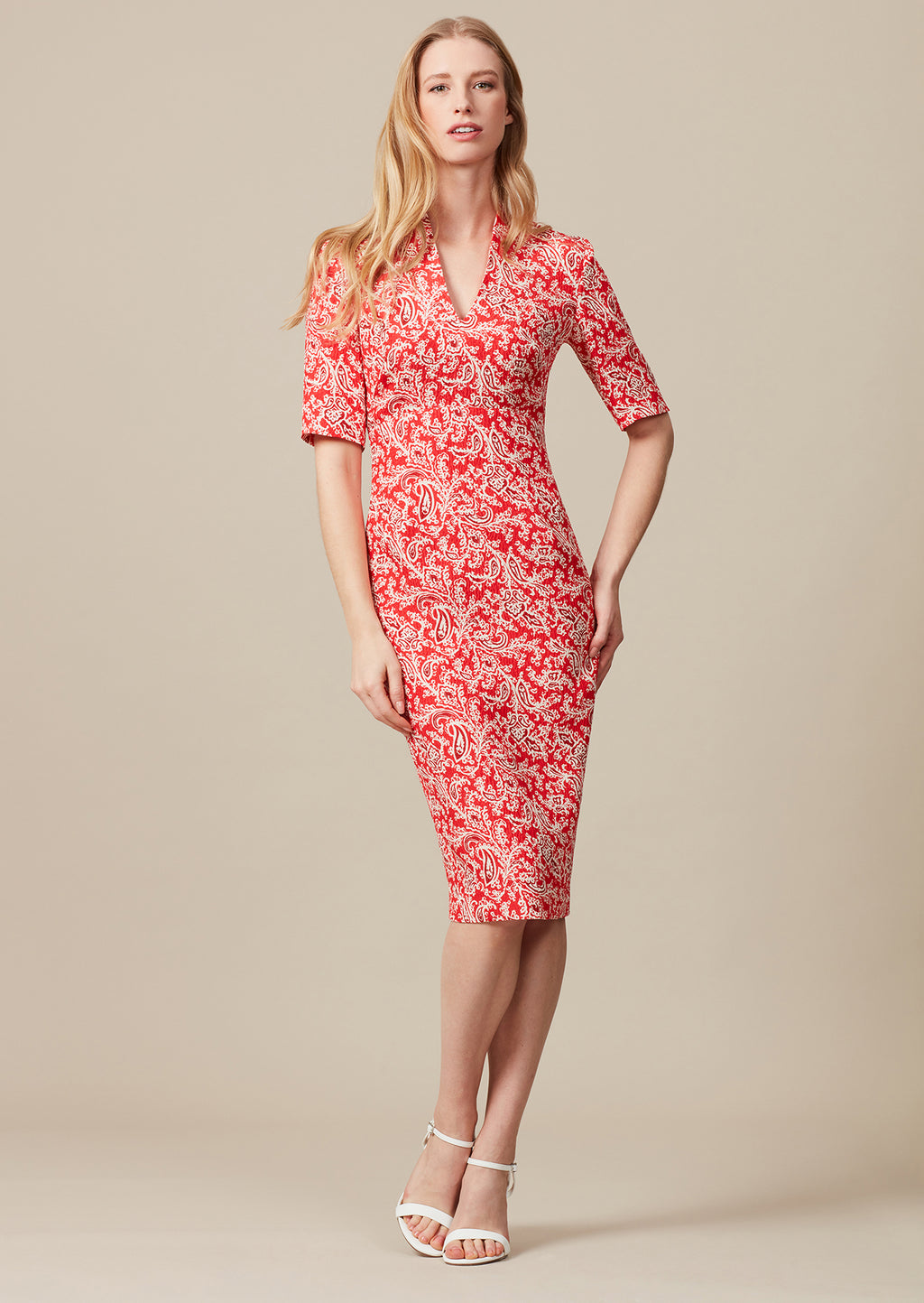 Scarlet  Cloqué Print  knee-length dress with elbow length sleeves and V-neck.