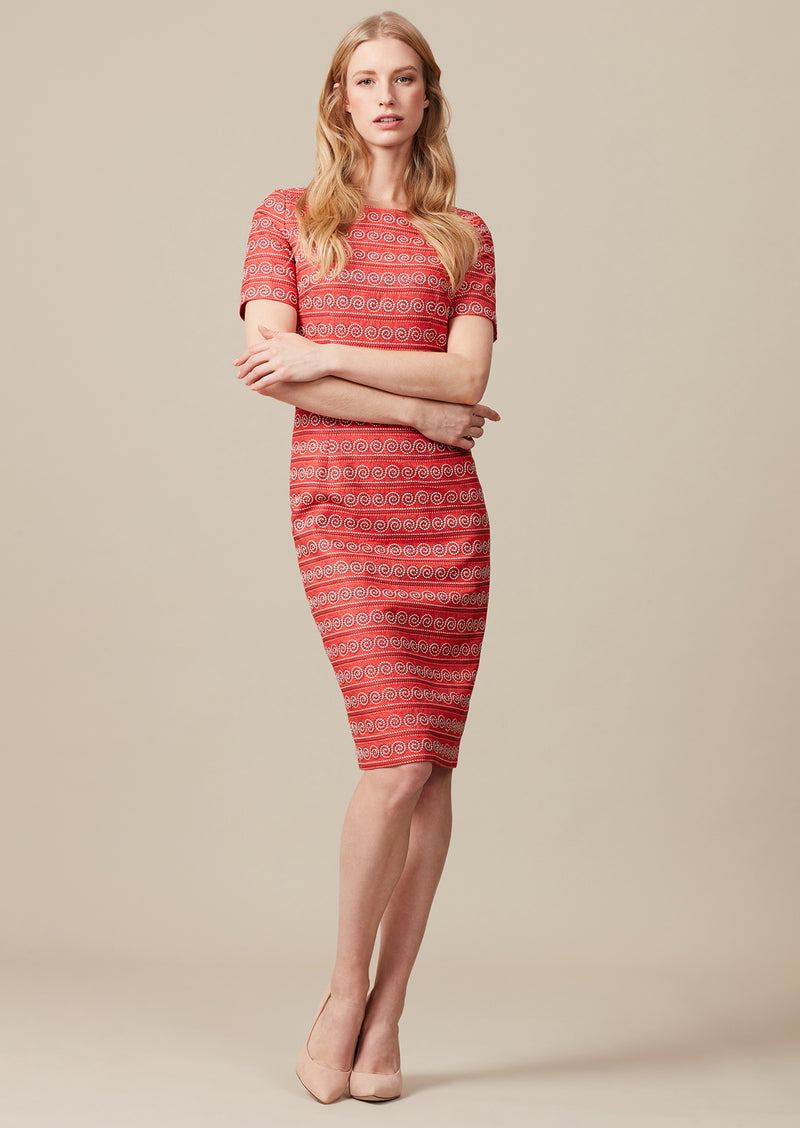 Embroidered silk dress with short sleeves and swirl stripe embroidery.