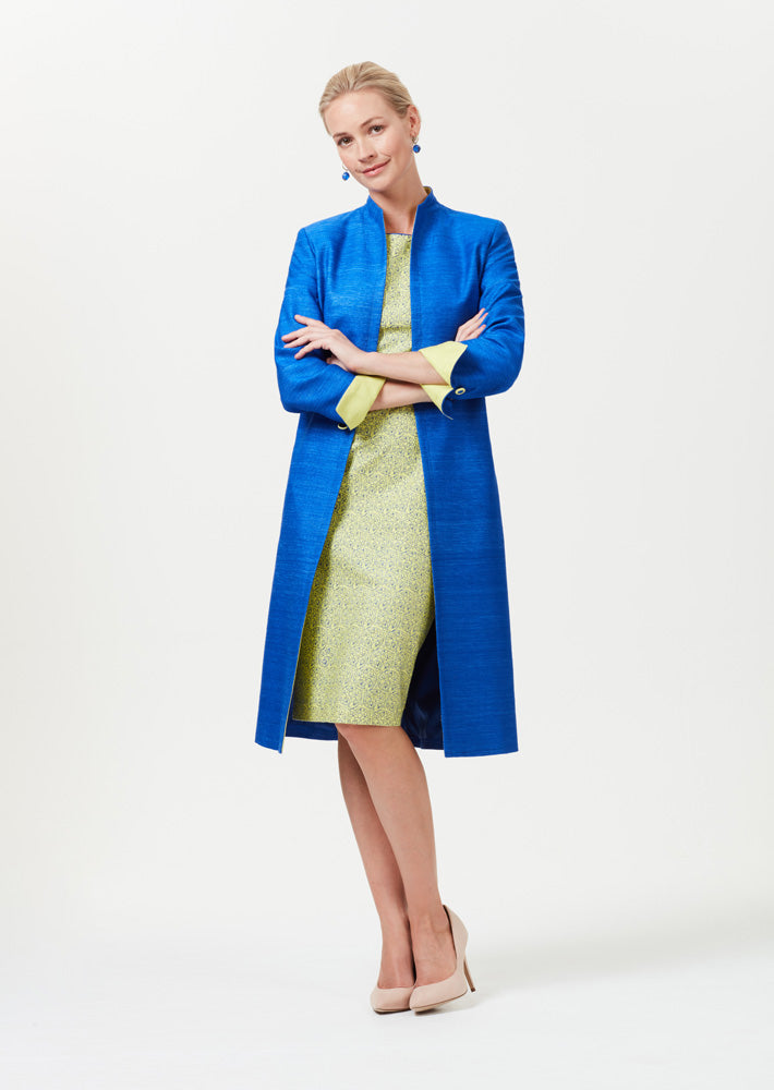 Duster coat in lime green with sapphire blue trim  - Leila