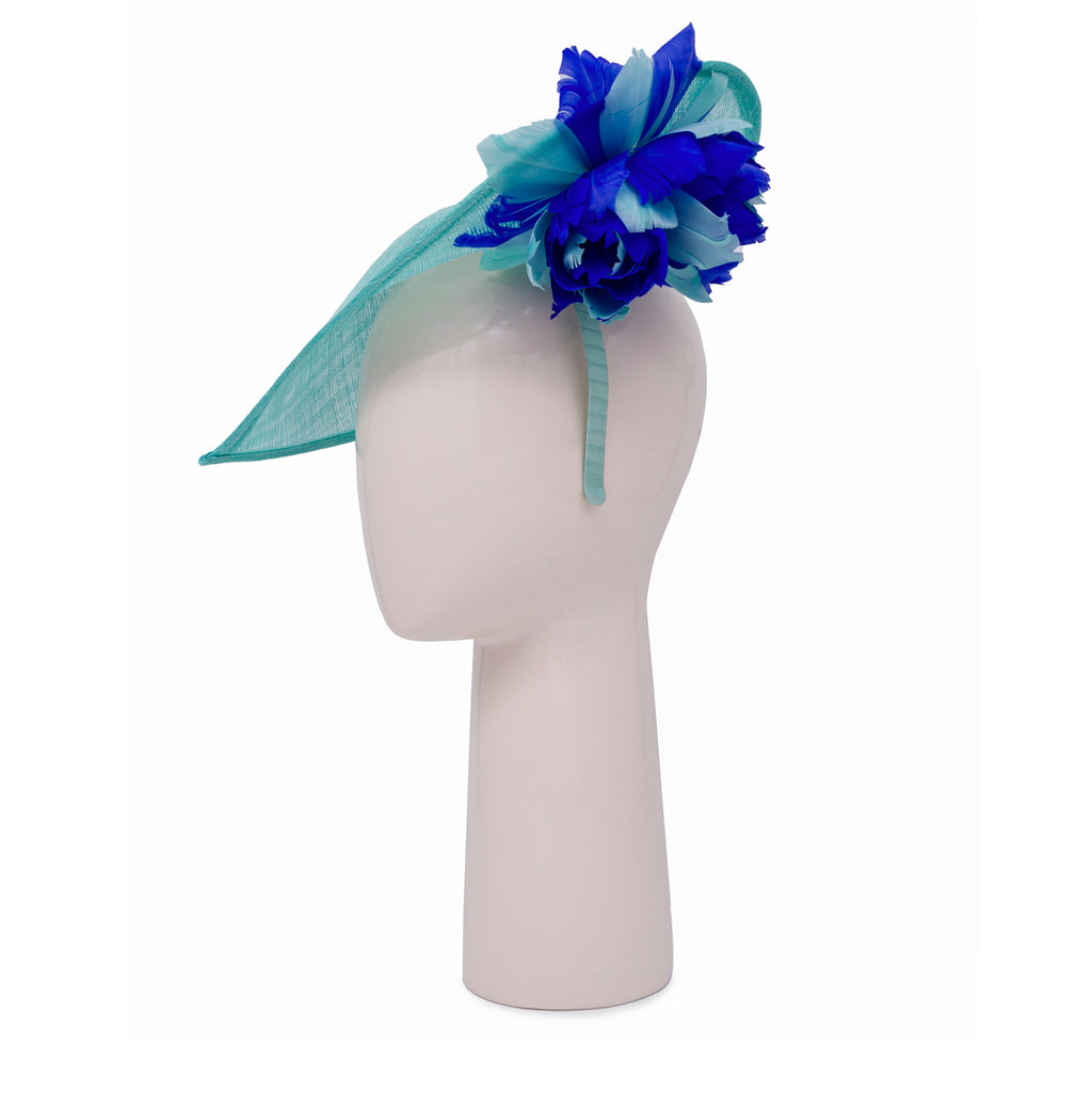 Heart shaped head-piece with feather flower under brim in Aqua and Sapphire