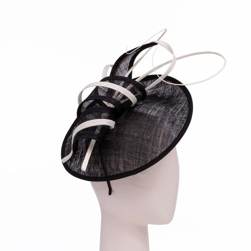 Small disc hat with scroll and quill trim in Black and Ivory