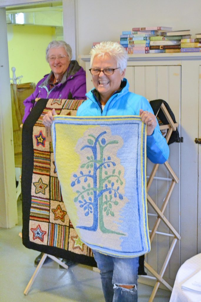 "Cindy Kimball with her kidney transplant ""Tree of Life"" logo rug."