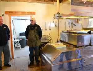 Slattery's owner next to the evaporator.