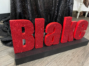 Name centerpiece- script name or block letter with base