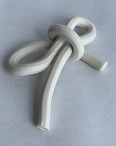 Bare porcelain, folded knot