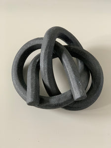 Textured, ebony teamster knot