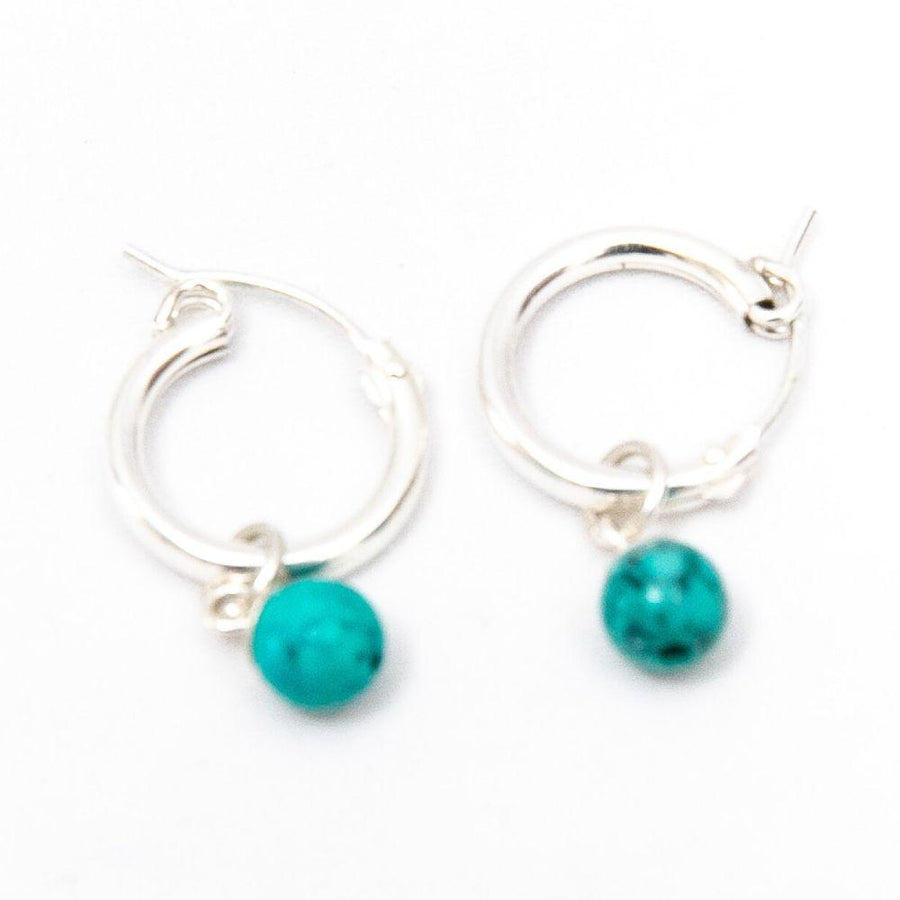 Silver hoop earrings with the yolight turquoise
