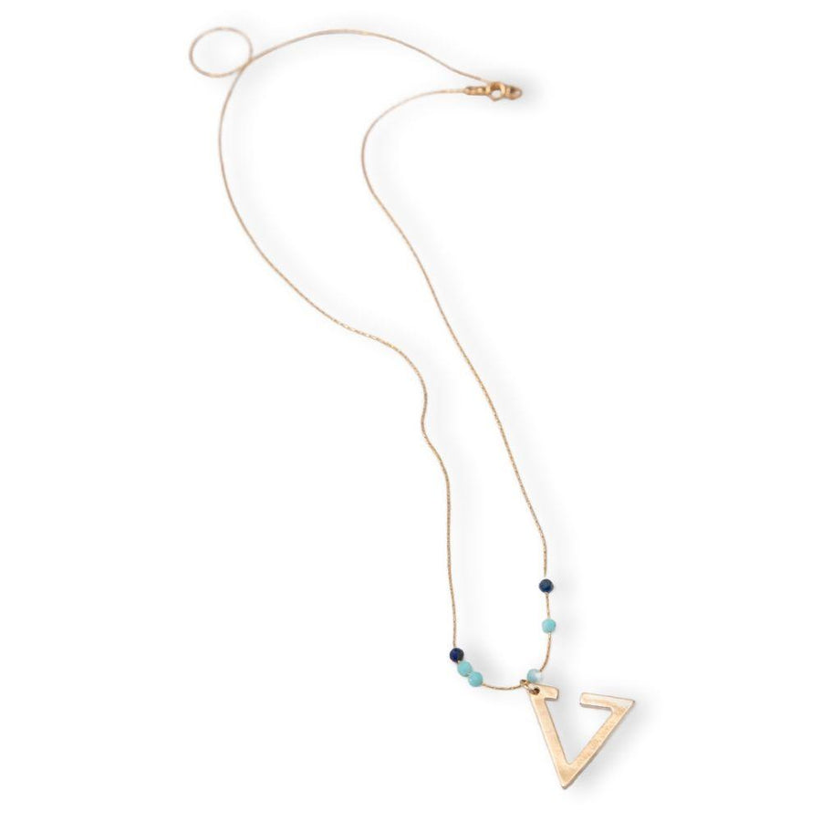 A gold necklace with a triangle pendant and a Lapis and an Amazonite.