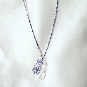 Silver necklace with engraved pendant and quartz