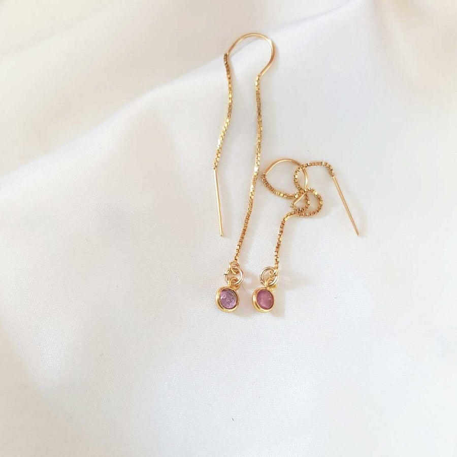 Elongated gold earrings with tourmaline