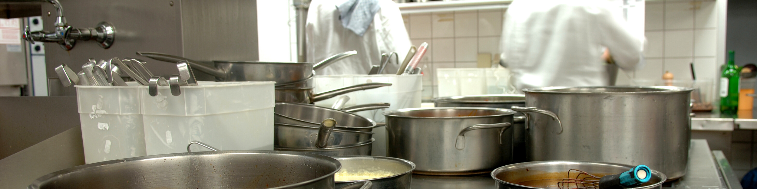 Restaurant kitchen with pots and pans in use