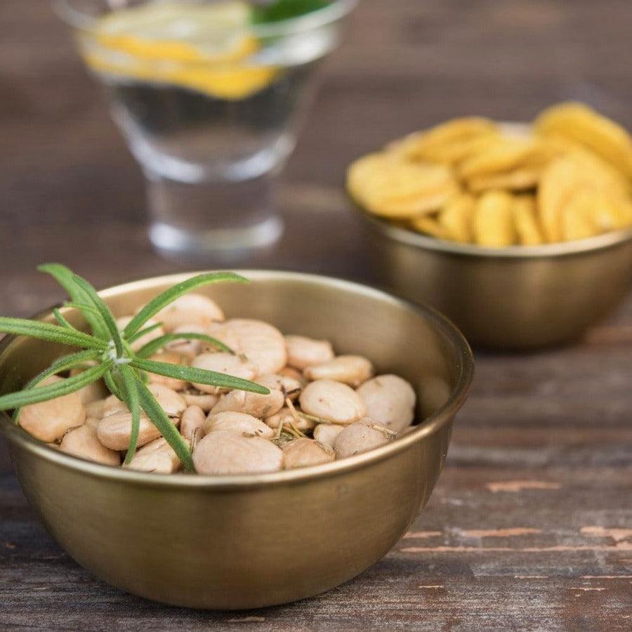 Brass Bowls by Fog Linen on the table with bar snacks