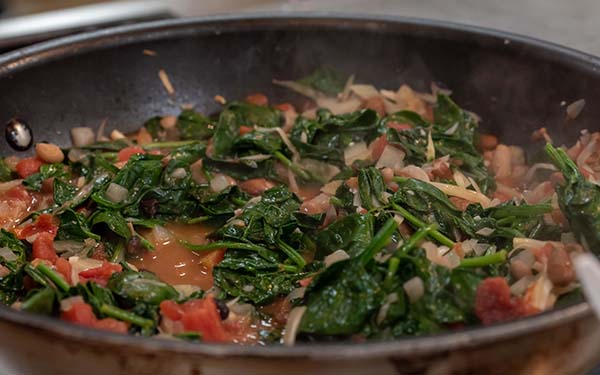 Cook until the spinach is wilted and the beans are just heated through, about 3 minutes.