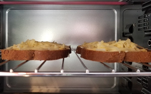 Meanwhile, preheat the broiler or a toaster oven. Spread mustard on bread and top with remaining cheese.