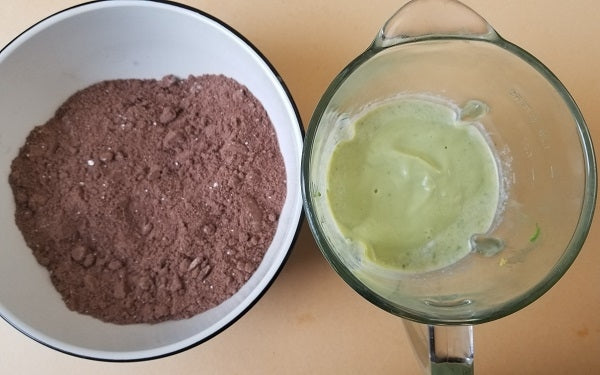 For the cake: In a large mixing bowl, combine all the dry ingredients thoroughly and set aside. In a blender or food processor blend all the wet ingredients until a smooth batter forms with no lumps of avocado.