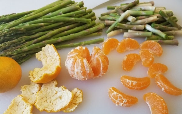 Trim the white base of the asparagus spears off. Peel, separate and clean tangerine segments of stringy white pith.