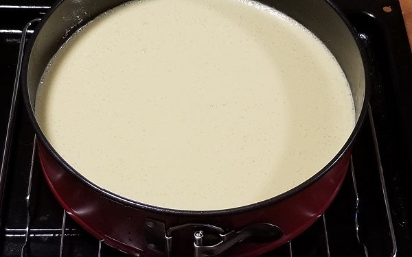 In a large mixing bowl beat cream cheese until light and fluffy, then add eggs one by one, scraping down the sides between each and mix until all three have been combined.