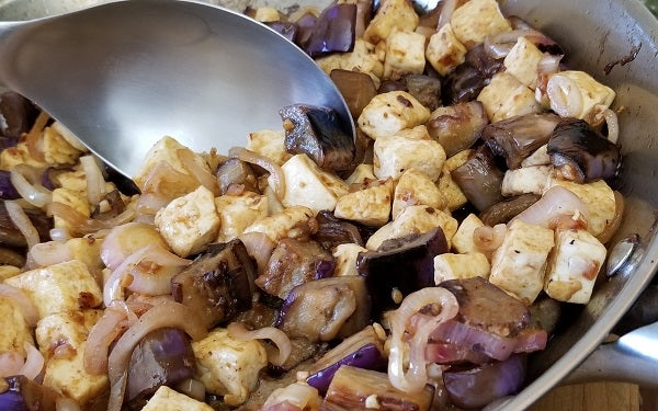 Stir in the eggplant and tofu pieces, continuing toss and cook until the sauce has thoroughly coated all. Serve over rice or enjoy as a standalone side dish!