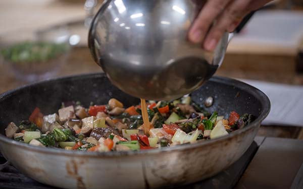 Add in the sauce mixture and stir to combine. Continue cooking until sauce thickens.