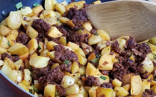 When potatoes have dried, reheat soyrizo oil over high heat until shimmering. Add potatoes and cook, tossing occasionally, until crisp and golden brown all over, about 15 minutes.